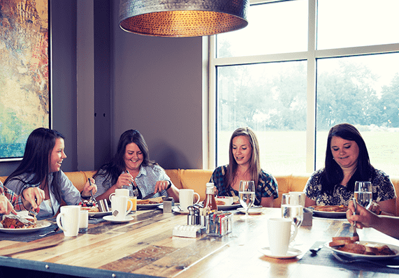 group of women eating breakfast at Forklift & Palate restaurant
