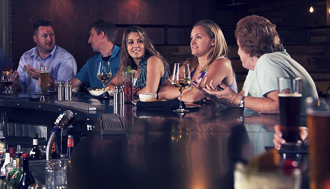 women dining at bar