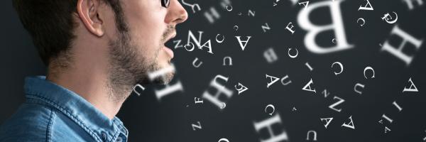 man-speaking-letters