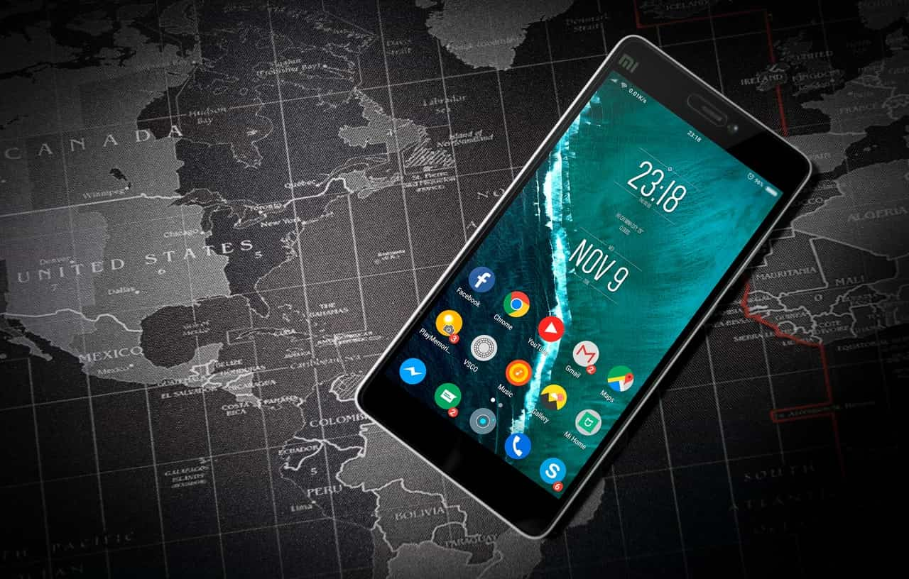 smartphone laying on map
