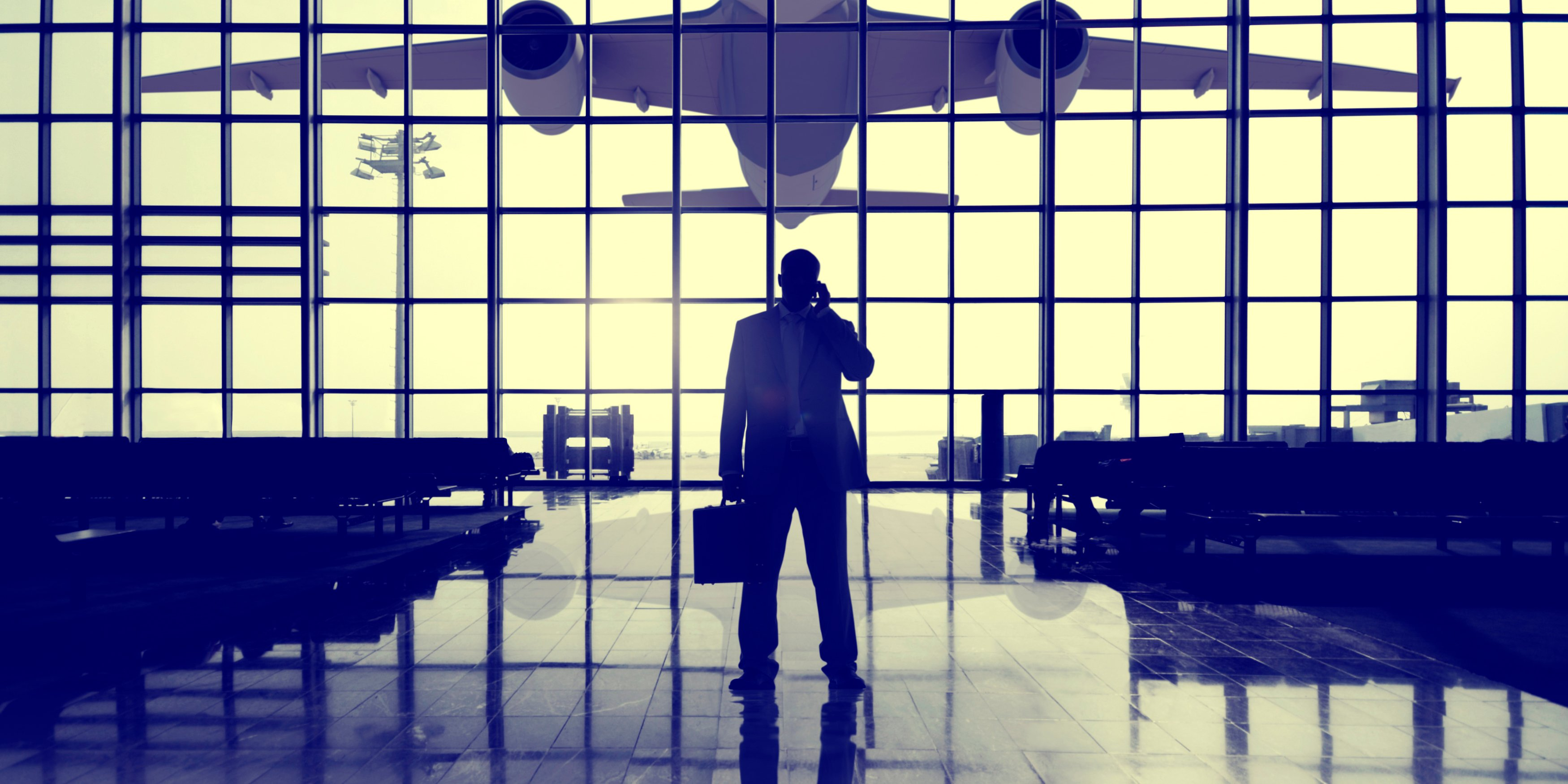 man-in-front-of-plane-in-air-port
